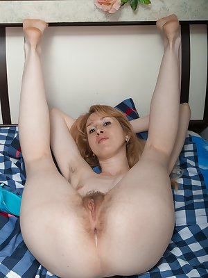 Sky Nikka is 28 and loves her blue lingerie and matching stockings. She poses with grace and shows off her very hairy pussy with such a delight. She spreads wide, opens her legs and loves to show it off.