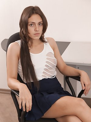 Dominique is on office girl who loves her pens, but for dirty things. She uses her pen up her skirt and in her hairy pussy. She strips naked on her desk and drags the pen across her wet lips.