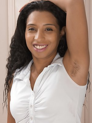 Divine shows off her hairy pits early and strips naked to lay on her floor. She opens her legs, displays her hairy pussy and is a petite American hairy beauty. She is quite hairy and pretty there.