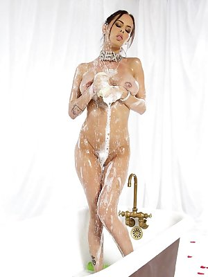 Solo model Brandy Aniston soaps up her nice tits and and twat in the tub