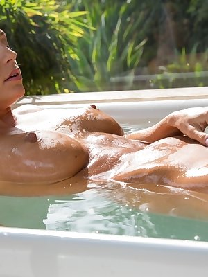 Wet babe with pretty face Abigail Mac baths her pussy outdoors