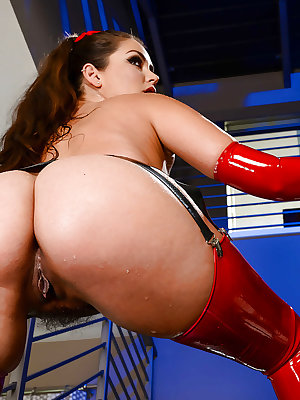 Pornstar Allie Haze exhibiting nice ass in red latex stockings and long gloves