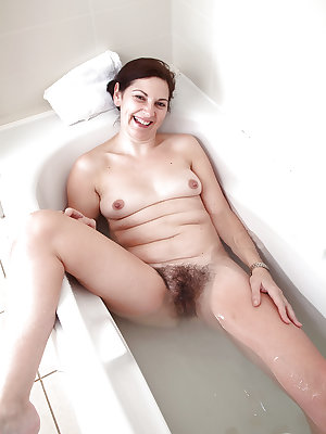 Close up pics of mature solo model Francesca tugging on pubic hairs