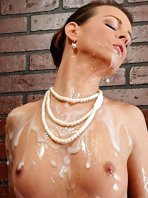 Classy broad in black cocktail dress gets drenched in cum at gloryhole