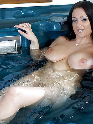 Brunette bikini model Alana Amrose is being all wet and horny