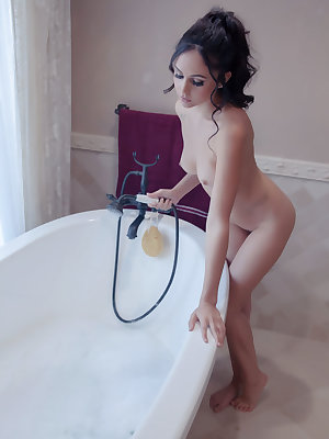 Latina beauty Ariana Marie soaps up her tits and pussy in a soaker tub