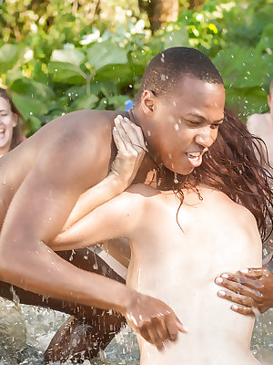 Amateur European boys and girls wrestle naked outdoors at the beach