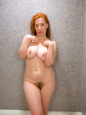Nude redhead Titania rocks her huge boobs and hairy muff in the shower