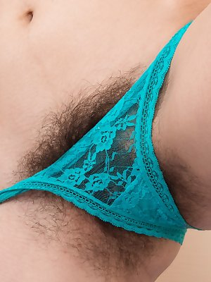 """Halmia is sexy in blue and strips naked on her blue bed. The dress and green lingerie come off, and she lays naked. Her 5'10"""" body has hairy pits and a sexy hairy pussy, and she looks amazing naked."""