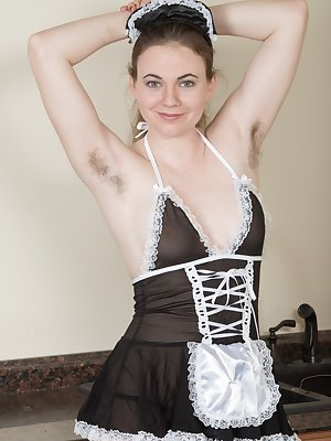Camille is the all-natural housekeeper and shows off her hairy pits. She strips naked taking off the outfit, panties, and stockings. Naked, she climbs on the counter and uses the brush handle.