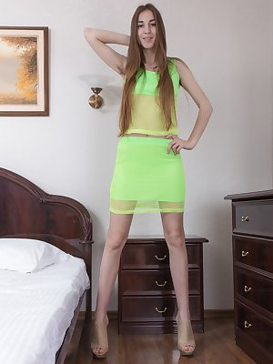 Halmia in her bedroom shines in her lime green outfit. She slowly undresses and shows off her 34C breasts and hairy pussy. Crawling to the bed, she opens her legs up more and fingers herself nicely.