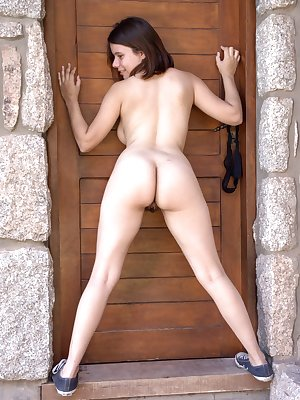 Akito is out in the village and strips naked outdoors. The dress comes off and her 38B breasts and hairy pussy are shown outdoors. She poses seductively and shows how sexy her natural Latina body is.