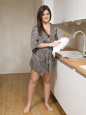 Mary K feels sexy in her kitchen and she strips off her robe and lingerie in excitement. Her 19 year-old all-natural figure sports a young hairy pussy. She spreads her legs and looks wonderful there right?