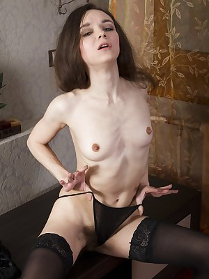 Lisa Li poses seductively and erotically by her table dressed in black. Her 34 year-old Russian body has a full hairy pussy and a petite figure. She strips on the table and shows us all her beauty.