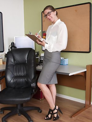 Valentine is in the office wearing her white blouse and grey skirt with heels. She shows her hairy pussy up her skirt and strips naked. She has hairy pits and then shows off her pussy on her chair.