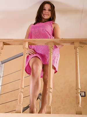 Leona comes down her staircase in her pink dress. Under the dress, we take a peek at her hairy pussy. Naked on the stairs, she spreads her legs, shows us her hairy pussy and her all-natural figure.