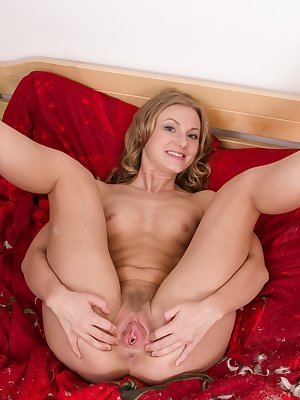 Nadin enjoys her pillow during slumber time and climbs in bed to enjoy it. Her blouse, lingerie and stockings come off quickly. In bed, her naked body sprawls across the sheets showing her hairy pussy.
