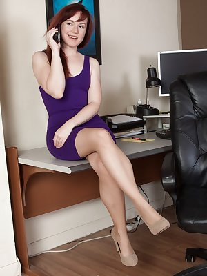 Annabelle Lee is stunning in her purple dress. As she spreads her legs, she shows all her hairy pussy underneath. The stockings come off, and she lays across the desk showing off her all-natural body.
