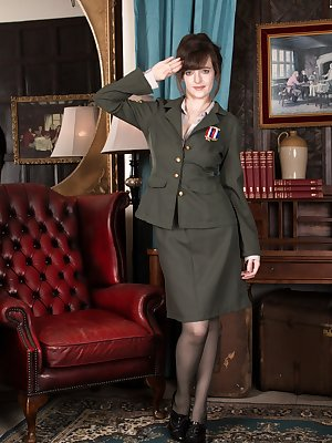 In her best military uniform, Kate Anne is the hottest ever. She uniform and stockings come off, and she reveals her hairy pussy. She crawls around the floor showing off her all-natural body and is great.