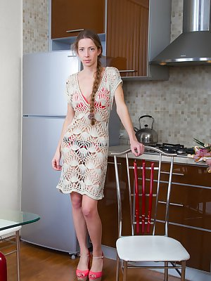 Ryisya shows off her flowers in the kitchen and is looking gorgeous. It makes her horny, so she undresses and spreads her young legs wide open. In between, is a very hairy pussy and long beautiful sexy legs.