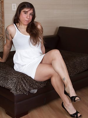 Mercedez is hot in white and is quite innocent. That is until she shows off her hairy pits and lifts her skirt to show her hairy pussy. When you get through the pics, her hairy bush is thick and beautiful.