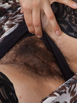 Mercedez is an all-natural California woman who in her stockings and dress is sexy. She shows off her hairy pits, tugs on her stockings, and shows her very hairy pussy. She masturbates rubbing her pussy.