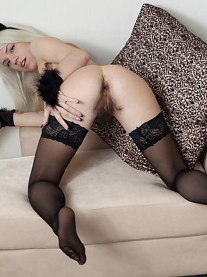 When hirsute porn model Selena is called to the set, she is surprised to find that she will be modeling a costume. She gets dressed as a kitten and slowly strips. As she strips, she fingers her pussy.