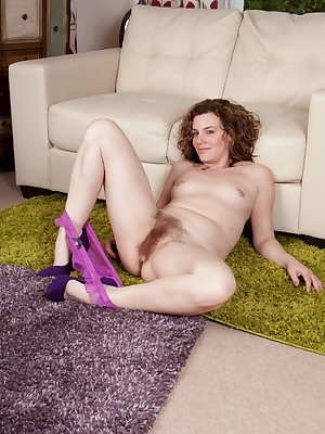 Sofia Matthews is in a delightful purple dress. This UK beauty has a delicious pair of purple panties and a sexy hairy pussy. She slowly strips and shows her naked body and plays with her hairy bush.