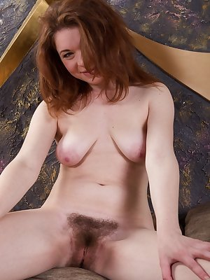 After school. Sasha Pink is home and needs to get naked. She squeezes her sexy breasts and strips naked. Naked, She erotically plays with her hairy pussy and long legs. She bends over and is so hot.