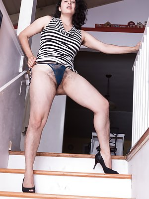 Wara is coming downstairs in her striped dress, and showing off her hairy legs and hairy bush underneath. She strips nude on the stairs, spreads her legs, and showcases her hairy body for all to love.