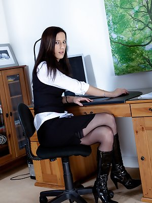 Sadie Matthews is at the office in an elegant suit, which she strips out of so she can show off her hairy pussy. She's a confident girl, and starts to play with her hairy mound while enjoying herself.