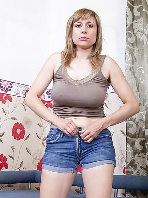 Nira is hanging out in her tight denim shorts and tank top when she gets the urge to play with herself. She takes it all off and gets knuckle deep in her hairy pussy in this hirsute porn.