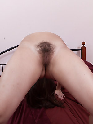Hairy girl Vera is in bed wearing a sexy dress and then she takes off her clothes giving a sexy striptease. And then shows off her her hairy pussy, hairy armpits and sexy body as she poses on the bed.
