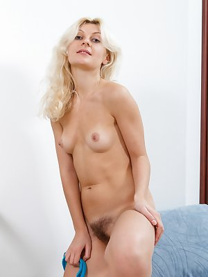 Hairy girl Fedora has some spare time so she slowly strips naked in her bedroom and then has some fun with her teal pantyhose as she gives a show while showing off her hairy pussy and long legs.