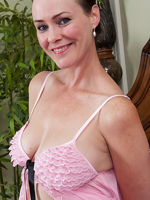 Beautiful Veronica Snow poses in sexy pink lingerie teasing the camera. slowly taking her top off and revealing her big tits then decides to stop teasing and expose her all natural hairy pussy.