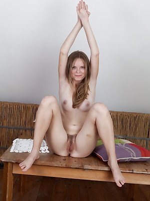 Denisma likes a little masturbation with her morning coffee. After getting her caffeine fix, this hairy babe flashes her tits then rubs a pillow on her hairy pussy.