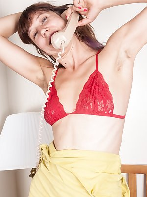 Hairy girl Valentine gets an important phone call from one of her friends and she knows exactly what to do. She strips off her dress, bra and panties, and then plays with her hairy pussy.