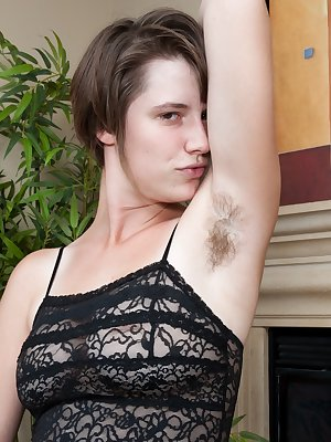 Jane is sitting in front her fire place, rubbing her hairy pussy through her night gown with her purple dildo. She lets her supple breasts come out of her shirt before removing the entire thing.