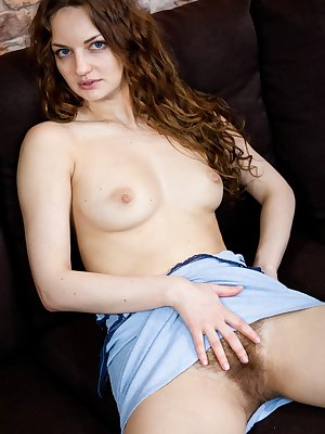 Blue looks great on the gorgeous Ginger, but she looks even better naked. She pulls her blue dress down revealing her perky tits, then pulls it up to debut her hairy pussy to the world.