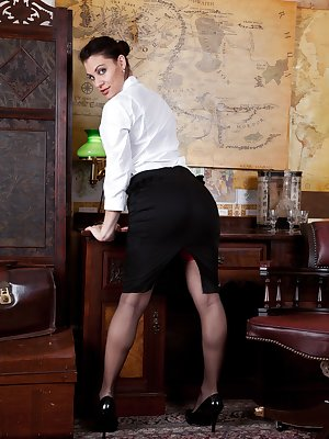 Roxy Mendez is a dirty secretary who is ready to seduce her boss with her red lingerie and sexy stockings. Once she's got him ready she takes it off to touch her hairy pussy for his viewing pleasure.