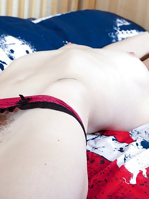 Louis Harmen is in a patriotic mood as she is on a flag bedspread and stripping her clothes off. She takes her time to seductively removes all her clothes and takes even more time to show off her hairy pussy pulling it wide open.