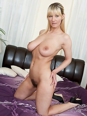 Blonde hottie Vanessa J doesn't have any trouble snatching eyes with her big beautiful breasts and tiny little tummy, but what really drives men crazy is the hairy mound above her moist beaver.
