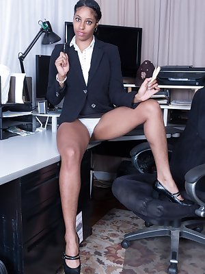 "In her office, Dharma Grace dresses in her back suit and white shirt. Done with work, she strips naked and wants to play. Her 5'10"" body has her hairy pits, hairy bush, and a perfect natural body under."