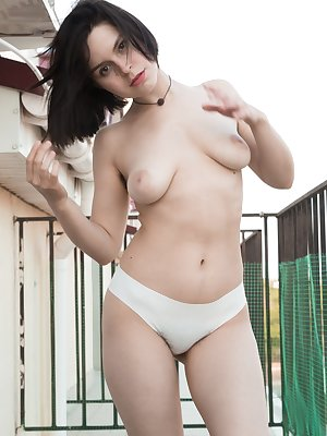 Ole Nina is showing off her hairy pits on her patio in her brown dress. She has white panties underneath, but comes inside to strip nude. She flaunts her body and the masturbates with her pink vibrator.