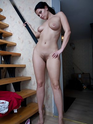 Indy is wearing sexy pink denim jeans as she uses a staircase as her stage. She starts taking her clothes off until she is naked. She then bends forward over the stairs and shows her hairy pussy off from behind.