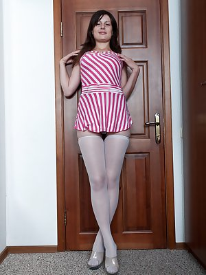 Gerda enjoys wearing a candy striper uniform with thigh high stockings to get your attention, before she lifts her dress up to show you a hairy pussy behind her panties.  She loves to touch it.