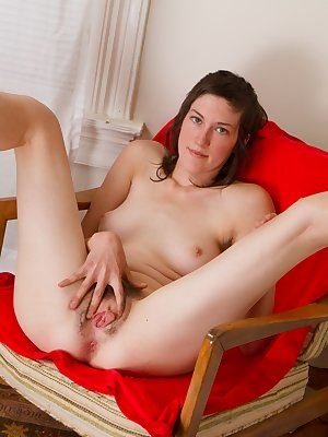 May sits proudly on a red chair with her legs spread apart. She opens up her hairy pussy with her hand and her sweet, pink pussy is for all to see. Her tight asshole is calling out for attention.