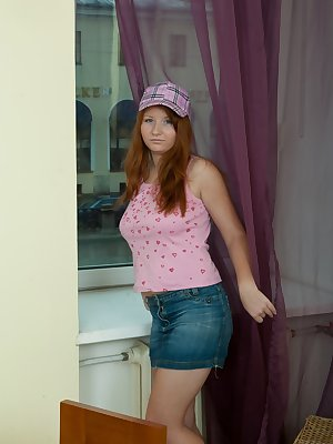Scarlett is a redhead with a pretty red haired pussy! She gets home and starts to look for her long double headed purple toy! She can't wait to get out of her clothes and play with her hairy pussy!