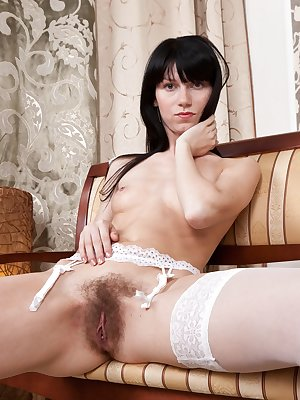 Bonya is dressed in white although that doesn't mean she is pure. She puts on a seductive dancing show and eventually shows off her sweet, hairy pussy. Her fingers go exploring into the wildness.