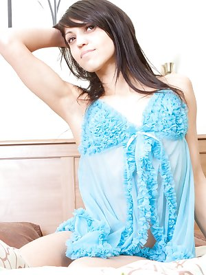 Peek through Fairy's blue lingerie as she mounts the bed and fucks her moist puffy vagina with her big dildo.
